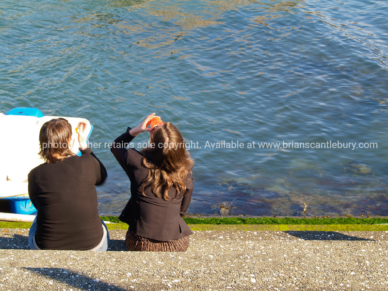 Girls sitting on Wellingtons waterfront, Oct 2010.  Model released; no, for editorial & personal use.