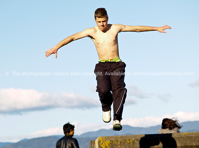Building jumpers practicing on Wellingtons waterfront, New Zealand, 3rd October 2010. Athletic males.  Model released; no, for editorial & personal use.
