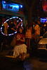 Hula, Columbia MO<br /> <br /> Another shot from downtown after the big win.  Outside of the Blue Fugue bar a couple of hippies dance with glowing props.  The woman with the hula, and behind her is a guy swinging around glowsticks on a string.