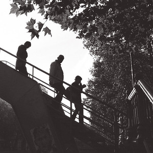 three descend the footbridge