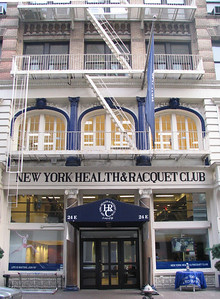 New York Health & Racquet Club - Jerry is talked into buying a racquet from a bad player posing as a tennis pro. Elaine works out with John F. Kennedy Jr. George gets in trouble for peeing in the shower. Jimmy slips on water that Kramer drooled from his mouth after too much novacaine.