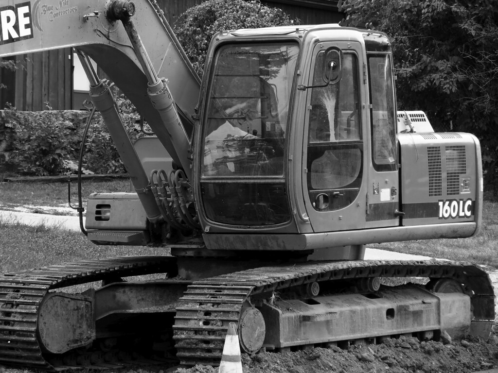The Deere 160LC excavator as a black and white image.