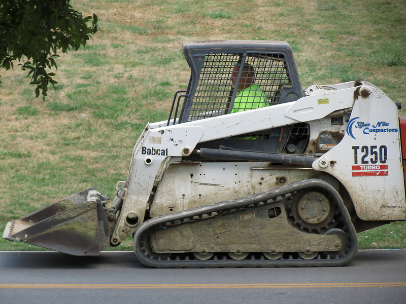 Bobcat - One of the excavating machines that is replacing one of the water mains on our street.<br /> Three different water companies have water mains on our street.