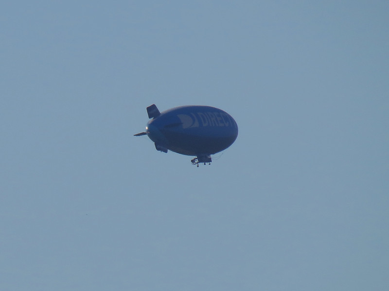 A blimp flying over the baseball stadium for the 2012 All-Star Baseball game.