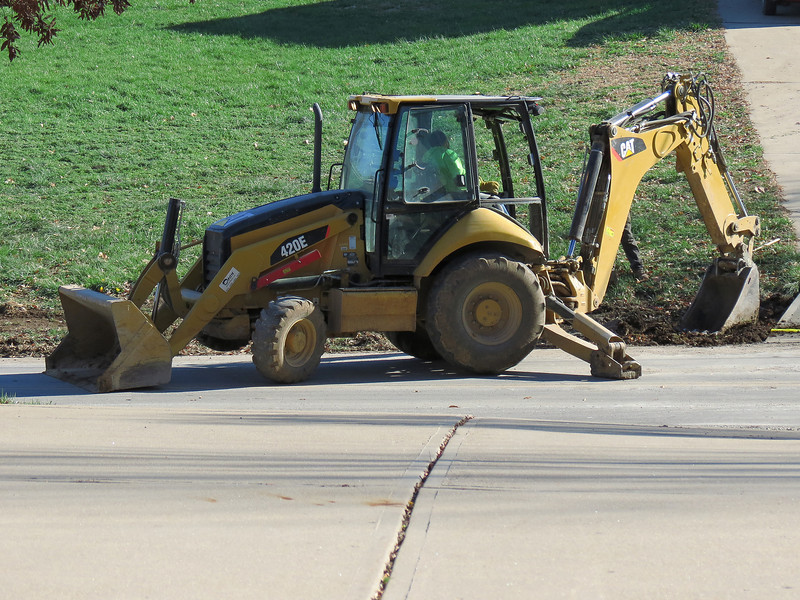 The CAT 420E backhoe finishing the culvert installation across the street.