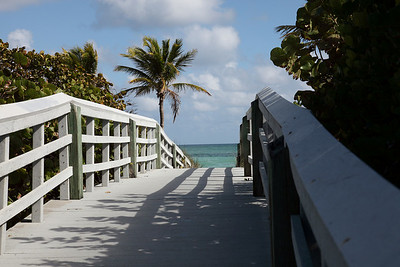 An entrance walkway to a Hollywood Beach, beach.