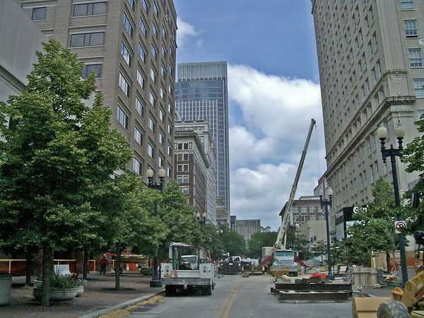 <font size=3>Looking North from the middle of 16th street.  The parking structure is on the left, (behind the tree) and the Orpheum on the right.  This view will be gone once the walkway is built.<br><br>That's the First National Tower in the distance.</font>