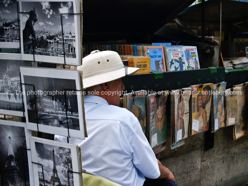 Street vendor of magazines,photographs,music. Paris, International City.