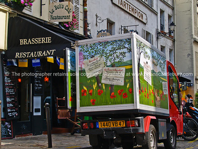 French bread delivery truck outside Montmatre restaurant., Paris.