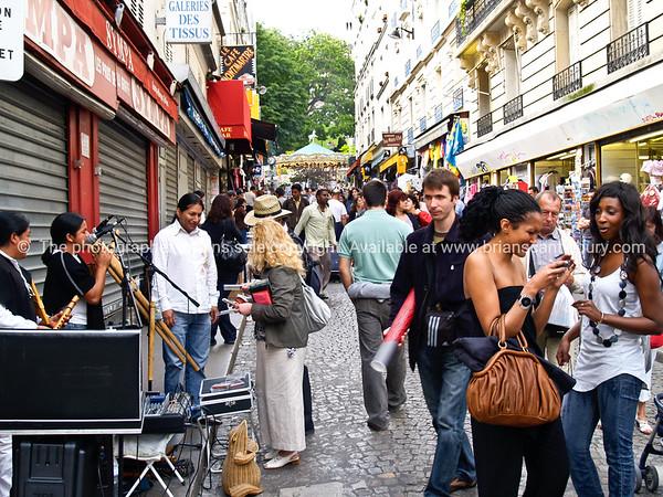 Montmatre, crwoded street, Paris, International City.