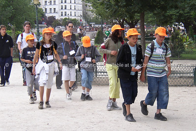 School children on tour. in their orange caps. Paris, International City.