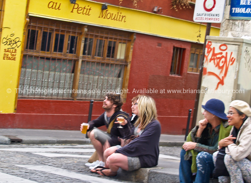Two two's, sitting on street corner watching life go by, Montmatre, Paris, International City.