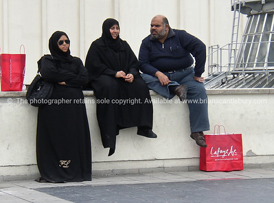 Shoppers, resting after the spend, Muslims on La fayette rooftop. Paris, International City.