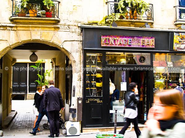 Street scene, quaint building, and alleyway. Paris