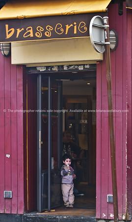 Entrance, with small boy. Paris, International City.