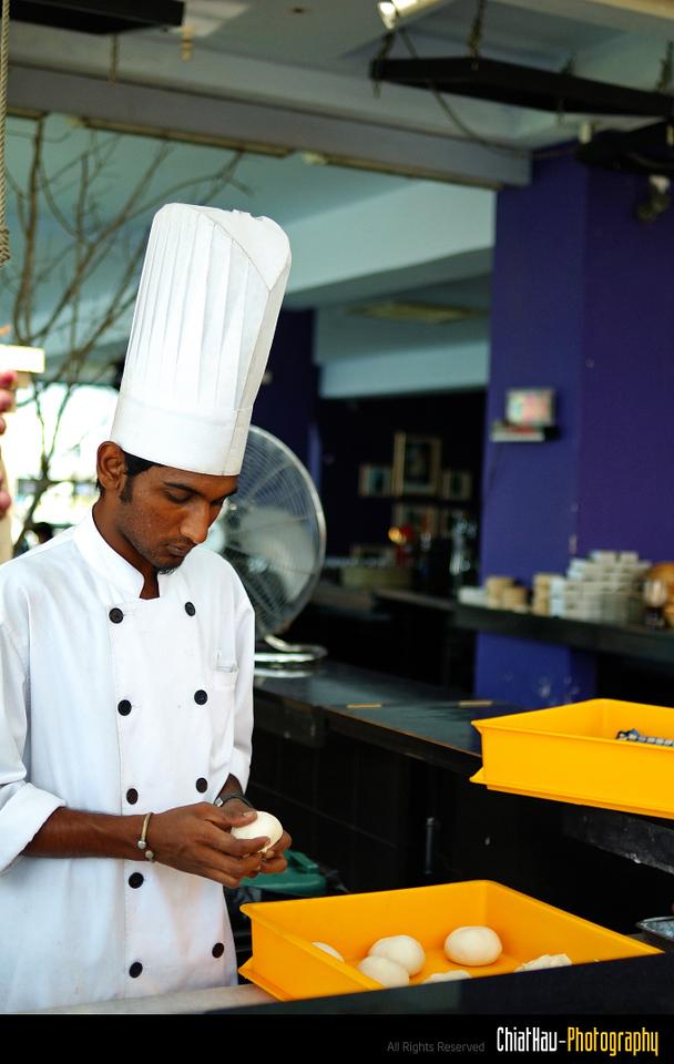 Chief in QEII Preparing bread for the customer. :)