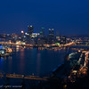 Pittsburgh at night showing the west end bridge and the Fort Pitt bridge.