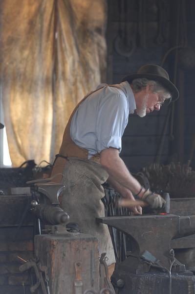 Blacksmith working at Mystic Seaport