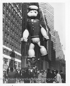 The flying of Popeye the Sailor Man in the Macy's Thanksgiving Day Parade by the Goodyear Aerospace Corporation, Litchfield Park, Arizona 85340