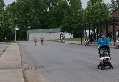 The two guys coming down the homestretch, yes the baby-stroller is ahead of them!