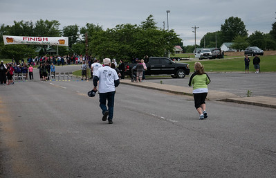 Father and daughter sprinting for the finish line...