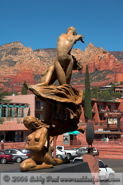 The beautiful Red Rock cliffs of the Sedona Mountians form a colorful background for this great sculpture of dancing faries in Upper Sedona, Arizona