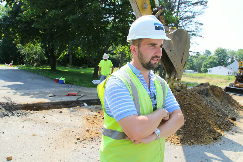 Engineer Nick Schwartz talks about the replacement of the water main on Williams Road in Ashburnham on Wednesday morning. SENTINEL & ENTERPRISE/JOHN LOVE