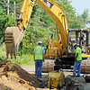 A crew works on the replacement of the water main on Williams Road in Ashburnham on Wednesday morning. SENTINEL & ENTERPRISE/JOHN LOVE