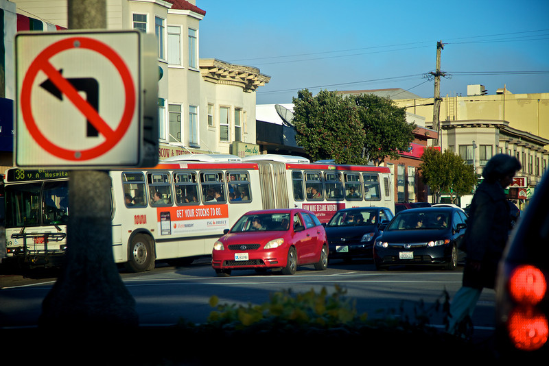 cars, buses, signs, pedestrian