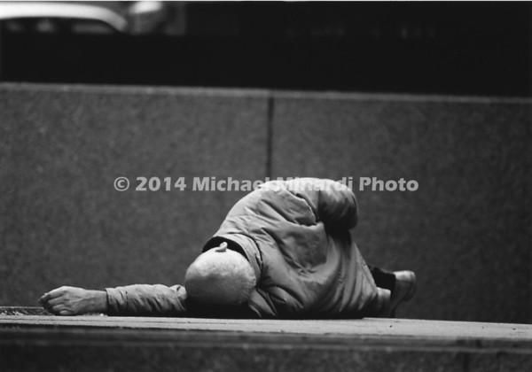 Man sleeping on sidewalk in Boston img056