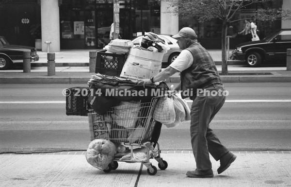 Man pushing grocery cart img093