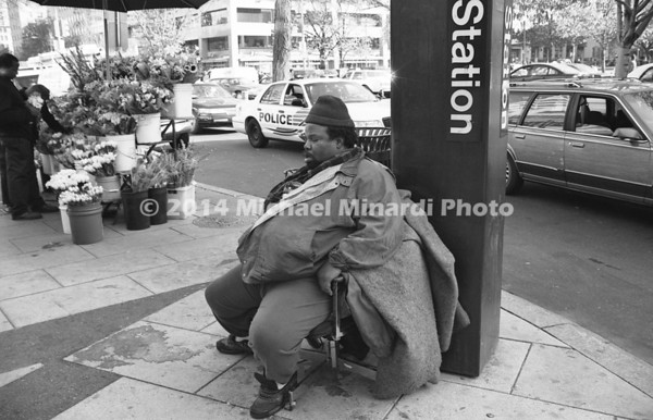 Large man sitting at corner sleeping 031