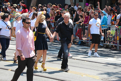 San Francisco District Attorney George Gascon marching with his wife - celebrating Pride.