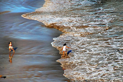 Wave Runners - children play in the surf at Cabrillo Beach in San Pedro.Photo won first place in 2011 Daily Breeze Photo Contest -