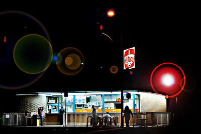 The bright lights of a traffic signal and a late night diner in San Pedro cast a giant spotlight on a long standing tradition at the corner of 9th and Pacific presenting patrons feasting on their Mexican fare as they watch the world go by.