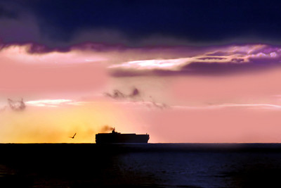 A freighter heads out to sea at dusk -