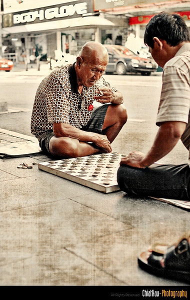 Based on the information I got, this uncle (with cigarette in his hand) is on their top chart for street board game... (Hoho..., they have chart as well!)