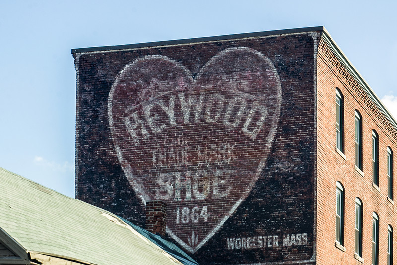 Heywood painted brick sign. Near the Union Station parking lot.