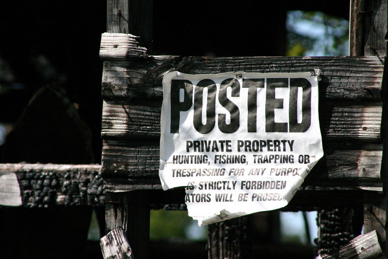 "Posted The sign reads, ""Hunting, Fishing, Trapping Tresspassing for any purpose is strictly forbidden. Violators Will Be Prosecuted.\"""