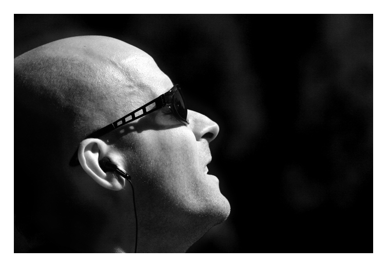 Alone in the Park - NYC, 2006.  in a crowded washington square park he belted out what he heard on his headphones.