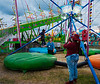 My parents had a cottage every summer at a local amusement park, so I grew up thinking a midway next door was normal. <br /> <br /> It must be mind-boggling for a kid today having only seen things like this in cartoons to be strapped into something that lets her bound tens of feet into the air and land softly while momma takes pictures.