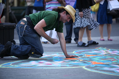 Street Photography in New York City. Union Square, 14th Street and surroundings. Sand painting artist at work.