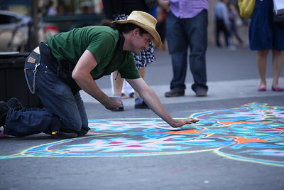 Street Photography in New York City. Union Square, 14th Street and surroundings. Sand painter at work.