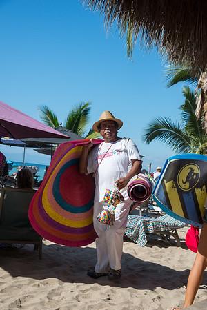 Straw hat and beach mat