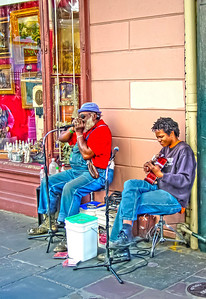 HDR photo of a street musician playing in New Orleans.