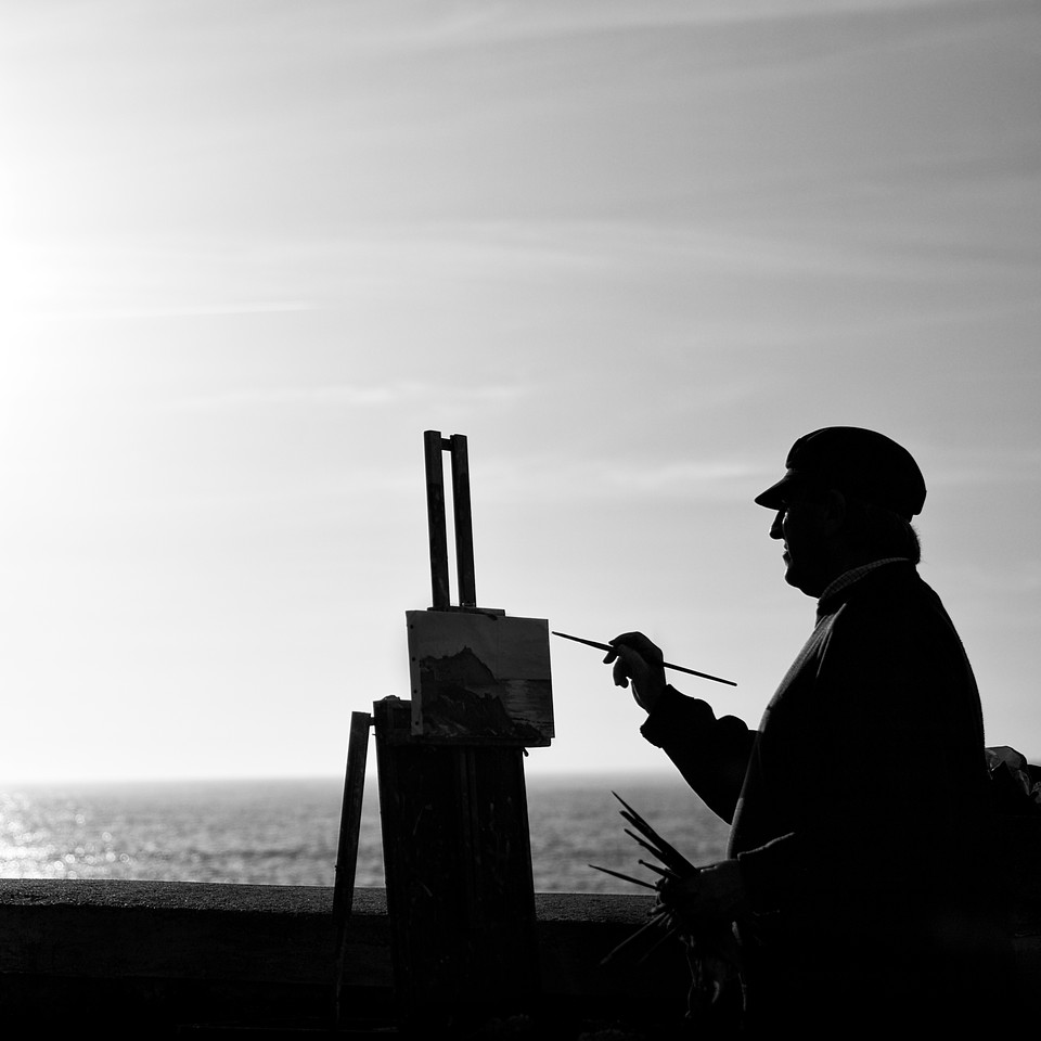 The Painter...<br /> A man paints the sunset over the ocean.<br /> (San Sebastian, Spain)