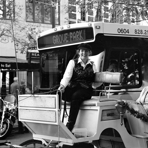 Portrait of a Carriage Driver in Downtown Asheville. Taken with a medium format Mamiya 6 on Ilford HP5+ film.