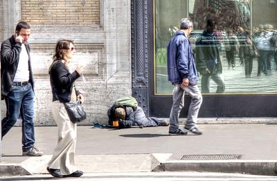 Beggar on a street in Rome.