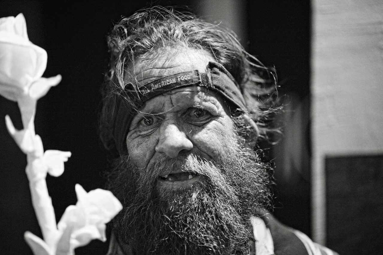 The Rose Man...<br /> This homeless man entertained us with stories and songs for half an hour while we were walking around downtown Houston shooting one night.<br /> <br /> He fashioned this amazingly detailed paper rose out of napkins he had collected throughout the day in hopes of selling it that night.