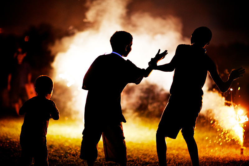 Light Dancing... 3 boys dancing around small fireworks. (Minnesota)